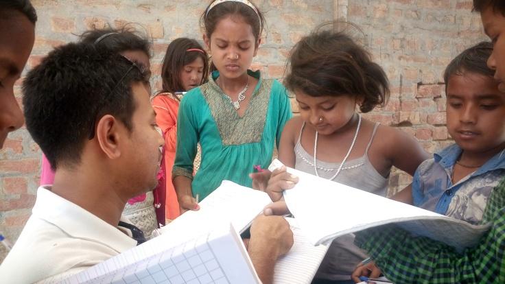 Children engrossed in maths sum with IIM-Rohtak professor Venkatesh Murthy.